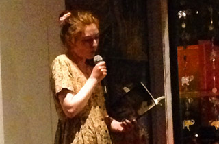 Author and poet Alexandra Naughton (novel, American Mary) reading at a spoken word event. Alexandra is part of a vibrant lit scene based in Oakland.